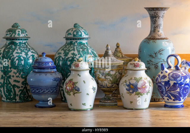 European and chinese antique vase on wooden table - Stock Image