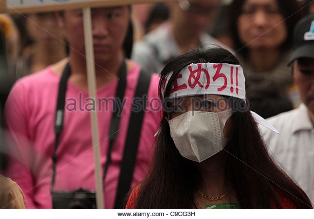 Protesters march against nuclear power in Shibuya, Tokyo, during an 'Energy Shift Parade', following the - Stock Image