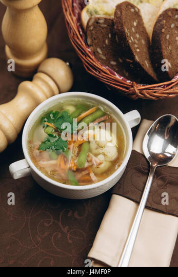 Cup of soup with bread - Stock-Bilder