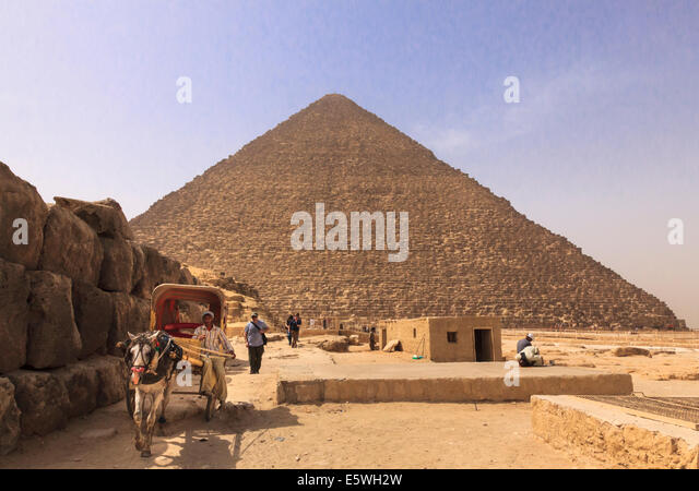 Great Pyramid of Giza in Cairo, Egypt - with horse and cart waiting for tourists - Stock Image