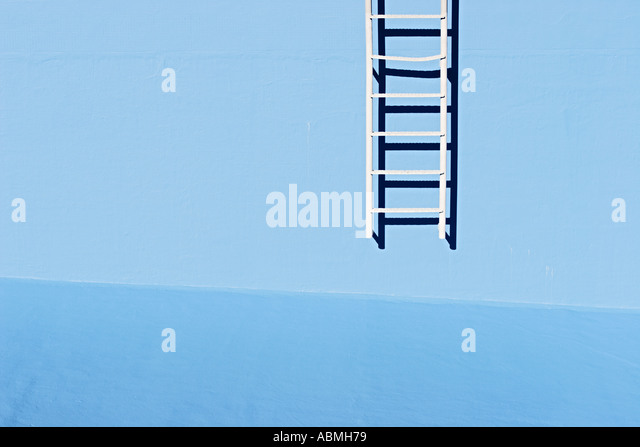 Ladder At Wall Of Empty Swimming Pool - Stock Image