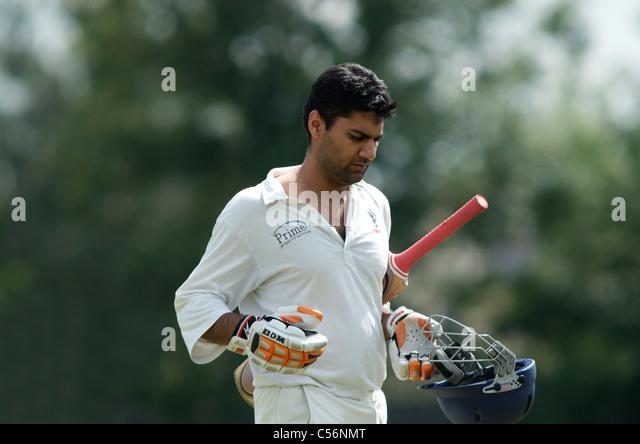 batsman returns to the pavilion after dismissal - Stock Image