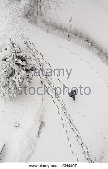 Walking in the snow - Stock Image