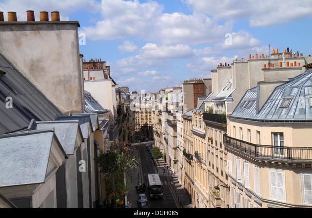 Paris France Europe French 9th arrondissement Rue la Bruyere rooftops historic Haussmann apartment buildings chimneys - Stock Image