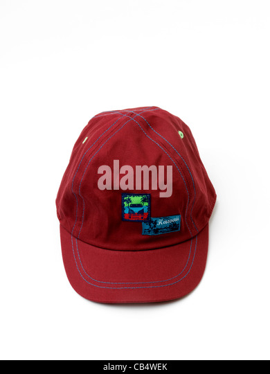 A Child's Red Baseball Cap - Stock Image