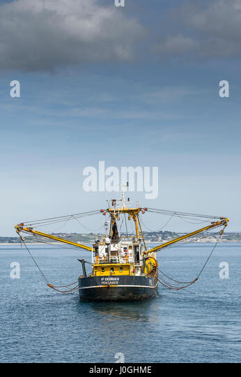 Beam trawler Leaving harbour Fishing vessel Fishing boat Fishing industry Starting fishing trip PZ1052 St Georges - Stock Image