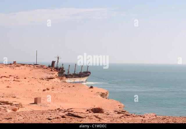 Mauritania, Cap Blanc, Nouadhibou, stranded cargo boat on shore - Stock Image