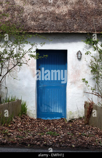 Front half door of thatched cottage, Ballyare, Ramelton, Co. Donegal Ireland. - Stock Image