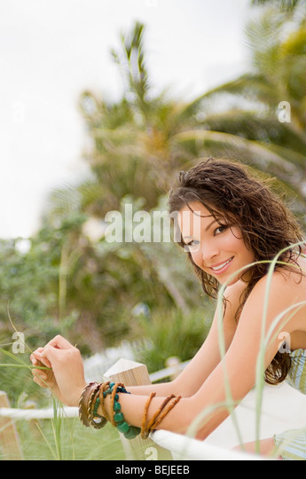 Portrait of a young woman smiling - Stock-Bilder