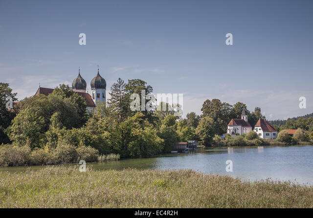 Seeon monastery is situated in the idyllic Klostersee lake - Stock Image