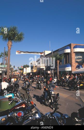 Daytona Beach Florida fl bike week bikers parading on main street - Stock Image