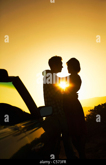 Silhouette of couple hugging - Stock-Bilder