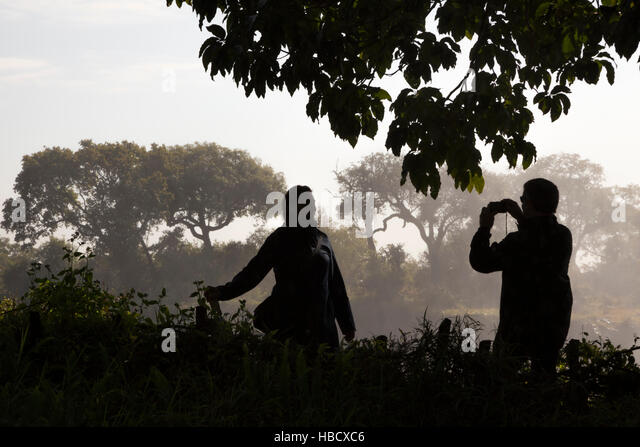 Tourists at Victoria Falls, Zimbabwe - Stock Image