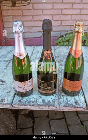 3 bottles of sparkling wine made at Georges Aubert Winery, Bairro Cairu, Garibaldi, southern Brazil - Stock Image