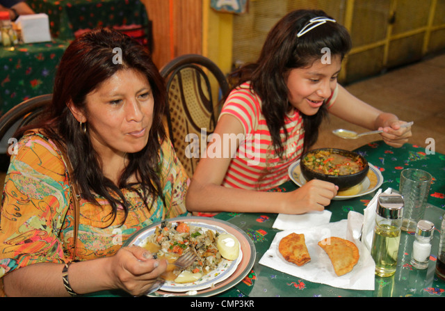 Chile Arica Mercado Colon covered market food court restaurant business dining typical food eating Hispanic woman - Stock Image