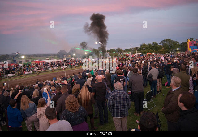 crowd at tractor pull pulling event motorsport public liability motor race racing spectators people crowds - Stock Image