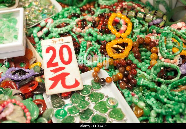 Jade jewelery at the Yaumatei jade market, Hong Kong - Stock Image