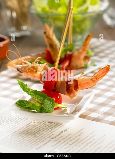 Shrimp and ham brochettes - Stock Image