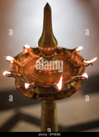 A 'diya' (or lamp) is filled with mustard oil and lit in the hallway of Ananda Spa, Ananda in the Himalayas, - Stock Image