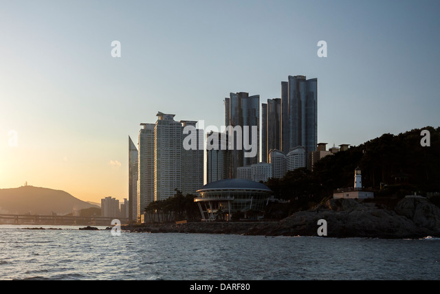 Dongbaekseom Island, APEC House, skyscrapers and Gwangan Bridge seen from the sea. The high rises include Parth - Stock Image
