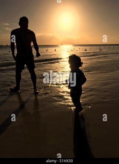 Family walking in sunset time - Stock Image