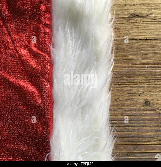 Cropped Image Of Santa Hat On Table - Stock Image