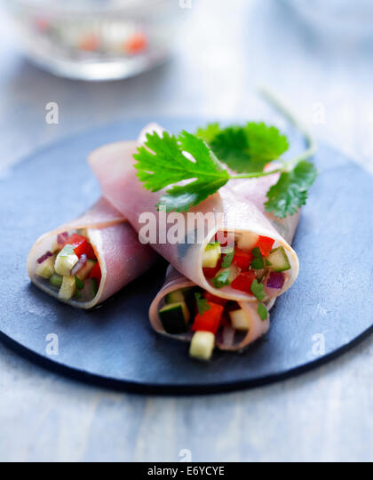 Bacon rolls stuffed with crisp diced vegetables and Mirin - Stock Image