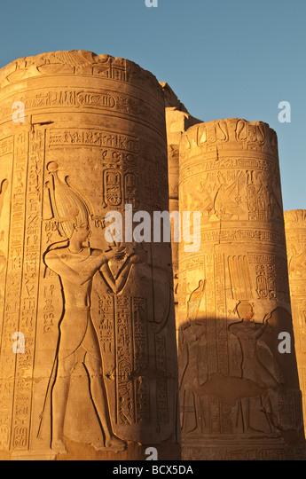 Egypt Kom Ombo row of outdoor pylons or columns showing pharaoh honoring the gods - Stock Image