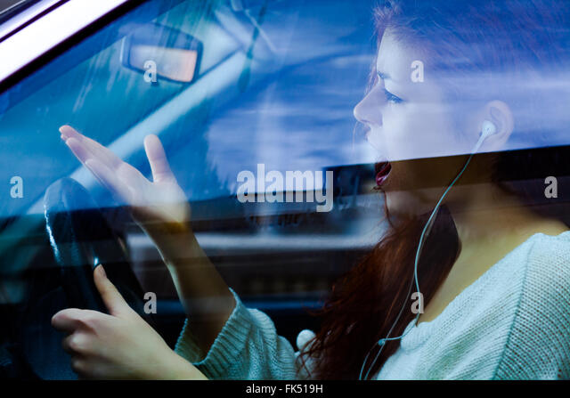 Angry Woman Shouting While Driving a Car - Stock Image