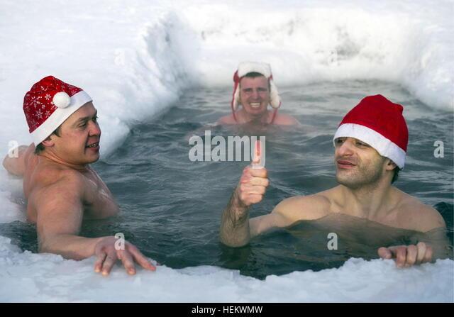 Novosibirsk, Russia. 24th Dec, 2016. Members of a winter swimming club swim in icy water. © Kirill Kukhmar/TASS/Alamy - Stock Image