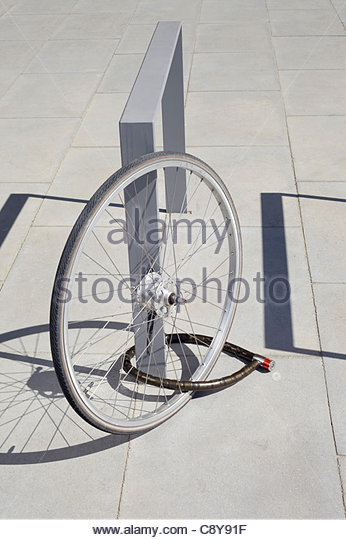 remains of stolen bicyle in street - Stock Image