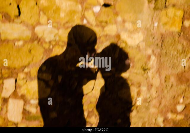 Shadow Of Kissing Couple On Street - Stock-Bilder