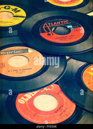 Old vinyl 45s from the early days of Rock and Roll music. - Stock Image