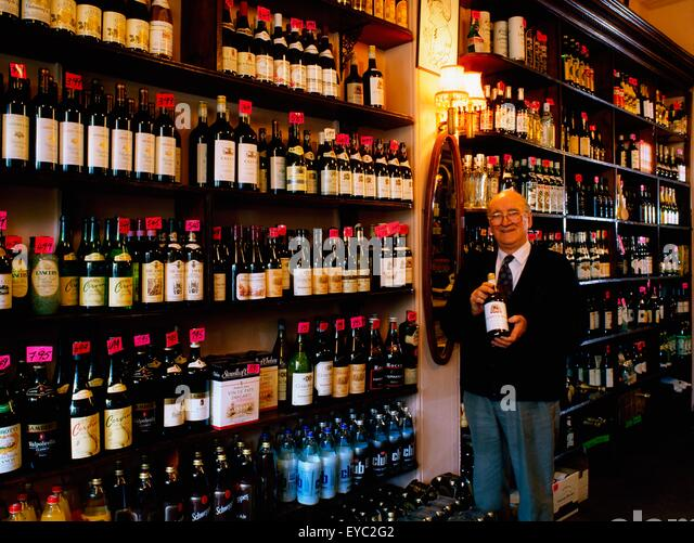 Liquor Store, Ireland; Man In An Off-License Liquor Store - Stock Image