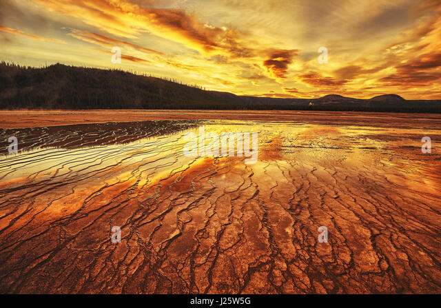Dramatic sunset at Grand Prismatic Spring in Yellowstone National Park, Wyoming, USA. - Stock Image