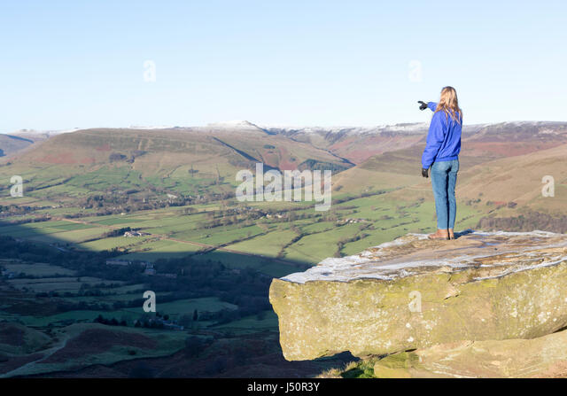 A walker admiring the view towards Edale. - Stock Image