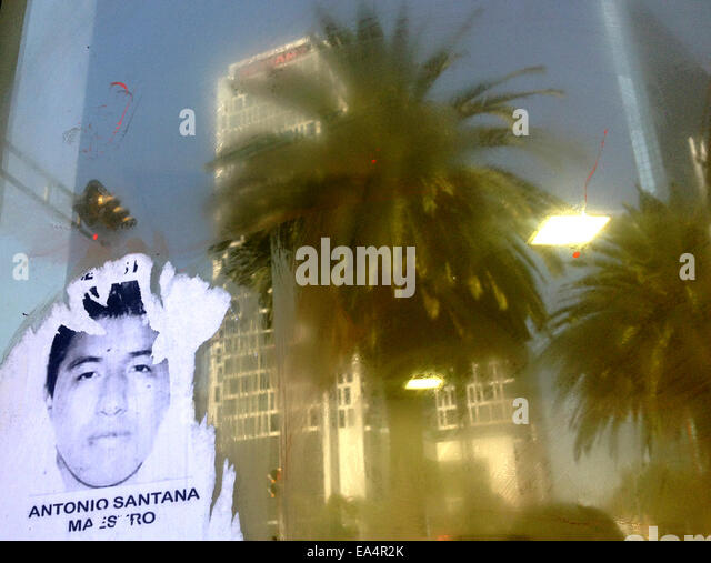 Mexico city, Mexico. 6th November, 2014. A portrait of missing student Antonio Santana is displayed  in Reforma - Stock Image