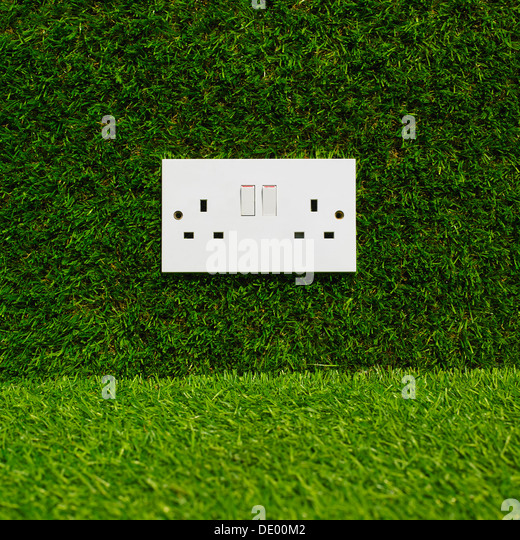 Electrical Plug Socket On Grass Background. - Stock Image