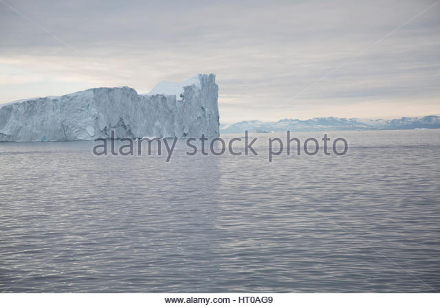 Sea of Iceberg Greenland Overcast Distant Disko Bay - Stock Image