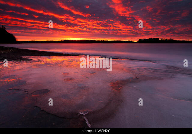 Winter sunrise in the lake Vansjø, Østfold , Norway. - Stock-Bilder