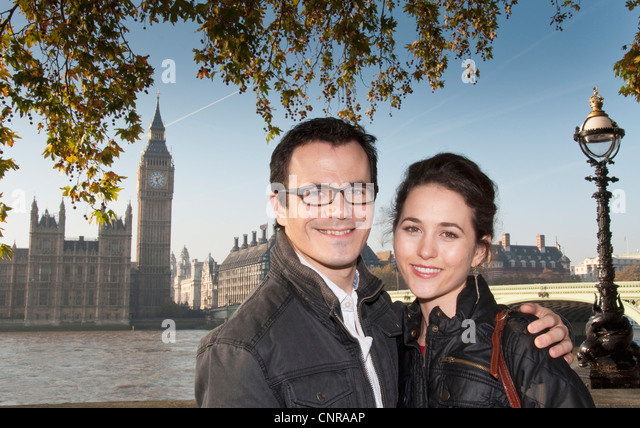 Couple outside House of Parliament - Stock Image
