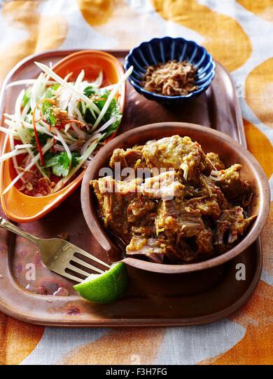 High angle view of Burma spiced pork on wood tray - Stock-Bilder