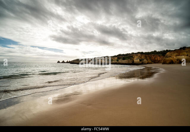 Beach and cliffs at Praia do Vau in the Algarve Portugal - Stock Image