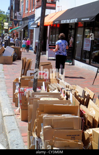 New Hampshire Portsmouth Market Square Congress Street trash containers curbside curb sidewalk flattened cardboard - Stock Image
