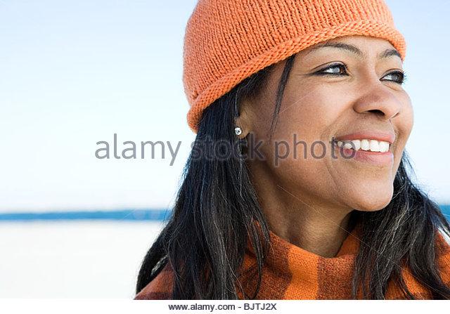 Woman wearing a knit hat - Stock Image