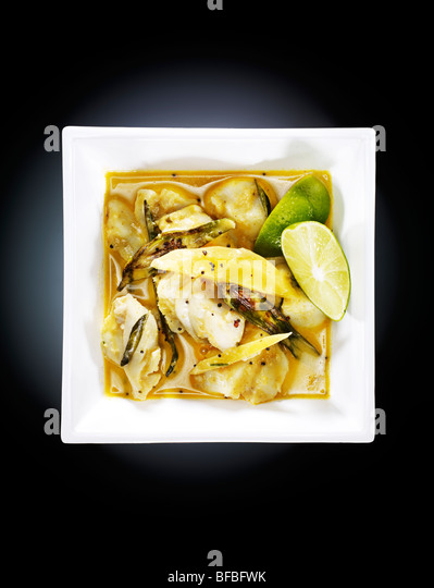 Alleppey fish curry, with green chili, red chili, tumeric and coconut cream - Stock Image