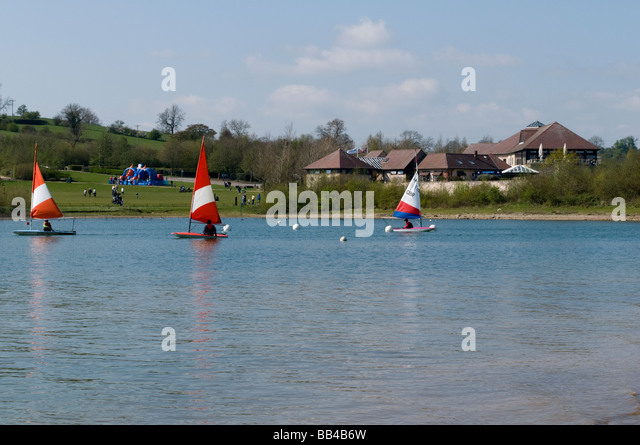 Water sports and Wind surfing at Carsington reservoir in the Derbyshire Peak District England UK - Stock Image