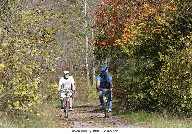 West Virginia Lewisburg Greenbrier River Trail cyclists - Stock Image