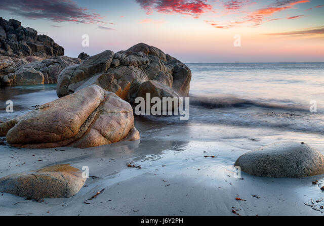 Sea sculpted rocks on the beach at Porth Nanven near Land's End on the Cornwall coastline - Stock Image