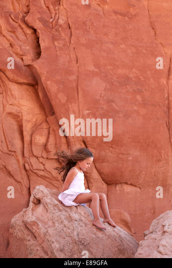 Girl on rock at Arches National Park - Stock-Bilder